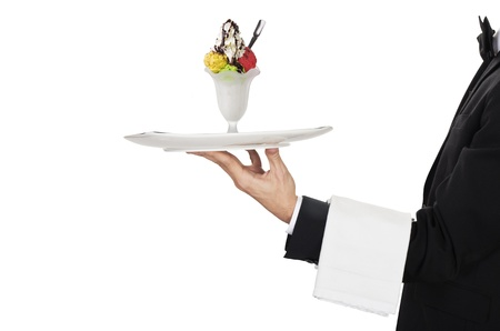 busboy: young waiter in work uniformon with ice cream Stock Photo