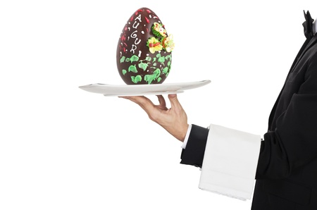 young waiter in work uniformon with easter egg