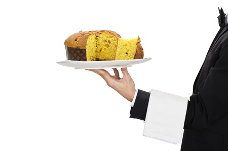 busboy: young waiter in work uniformon with panettone