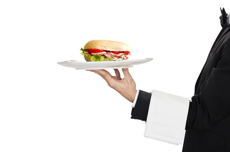 busboy: young waiter in work uniformon with sandwich