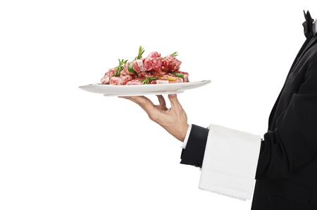 young waiter in work uniformon with sausage Stock Photo
