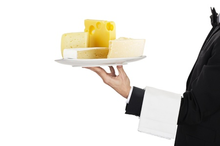 busboy: young waiter in work uniformon with cheese