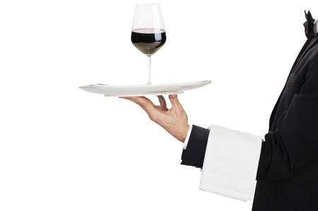 busboy: young waiter in work uniformonwith wine glass