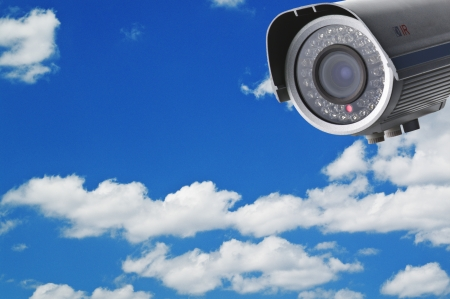 Security camera on the blue sky background photo