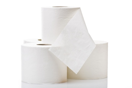 Rolls of toilet paper close up on white Stock Photo