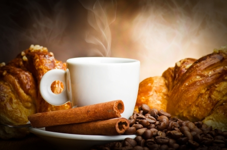 coffe bean: Coffee smoking on the coffee beans and croissant background