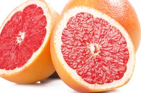sweet segments: Pink grapefruit close up on the white  Stock Photo