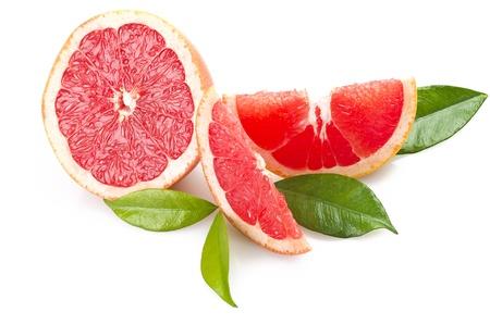 toronja: Pomelo rosa de cerca en el blanco