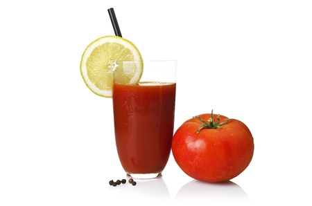 l natural: Glass with Tomato juice close up on white  Stock Photo