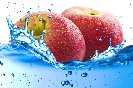 Apples splash in the water over white background Stock Photo - 21263782