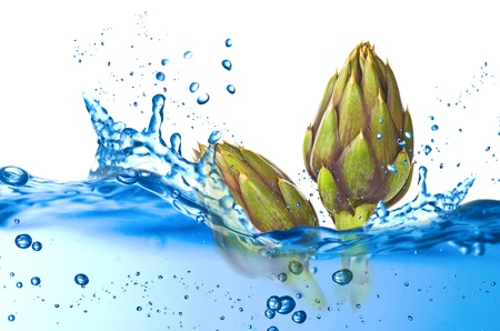 fresh artichokes splash on the white background Stock Photo - 21263783