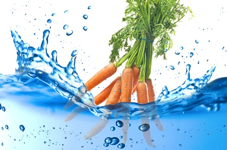 Carrot splash in the water over white background Stock Photo - 21263787