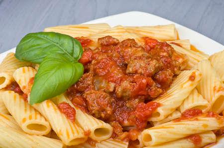 maccheroni: A dish of Maccheroni pasta with tomato souce and sausage