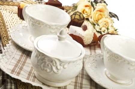 cup: Table set for high tea with cookies