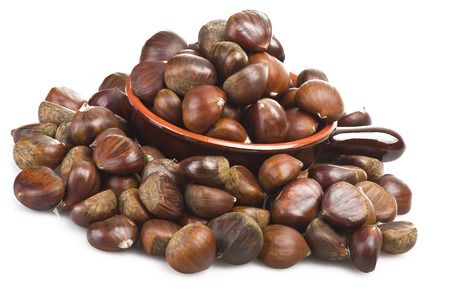 Bowl with chestnuts close up on the white  photo