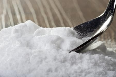 Iron spoon of baking soda close up  Stockfoto