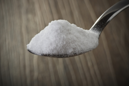 Iron spoon of baking soda close up  photo
