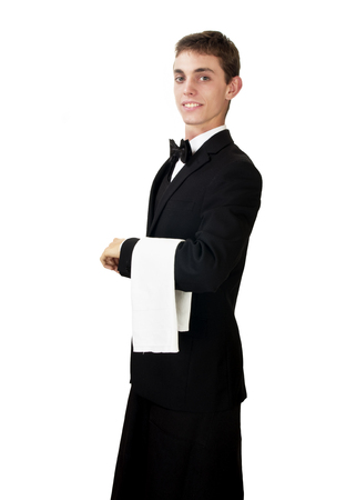 busboy: young waiter in work uniformon the white