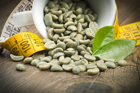 lose weight by drinking raw green coffee Stock Photo