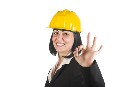 Happy young female architect working at the company photo
