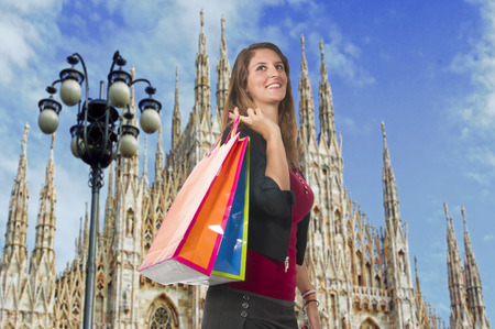 woman s bag: Woman smiling while doing shopping in the city