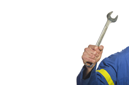 engineer's: Mechanic With His tool holding a wrench at a garage Stock Photo