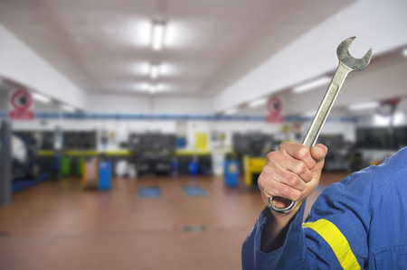 engineer's: worker on the shop floor while repairing a car