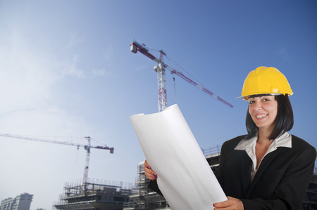 engineer's: Happy young female architect working at the new buildings