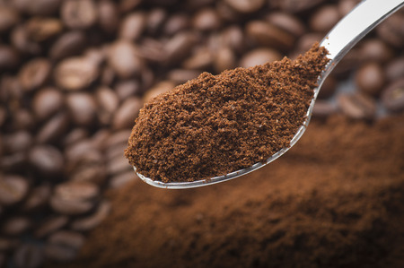 Iron spoon with coffee powder close up