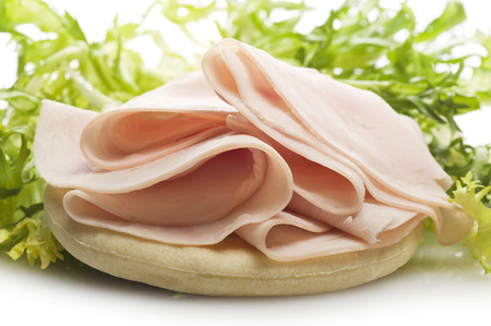 Turkey meat slices with salad on the white Stock Photo