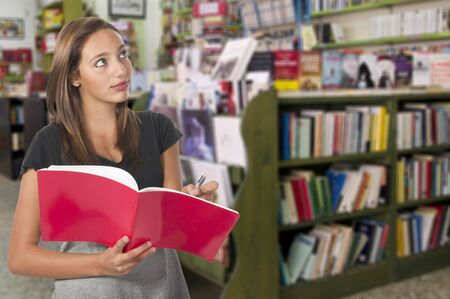 to think about: young girl in library think about what to buy