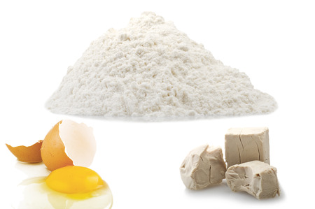 leavening: Flour,egg and Yeast cubes close up on the white Stock Photo