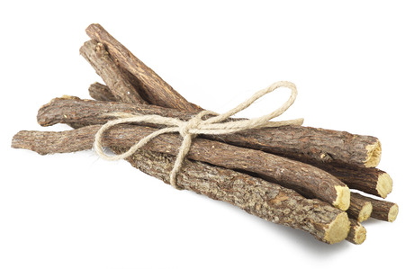 Licorice roots close up on the white 스톡 콘텐츠