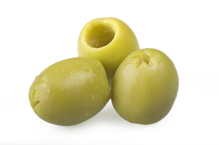 pitted: Pitted green olives close up on the white
