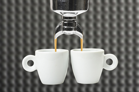 handle bars: An espresso machine group head  and two cup