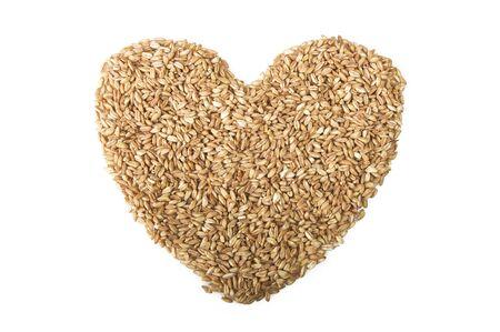 spelt: Spoon of Raw Organic Spelt Grain close up on white