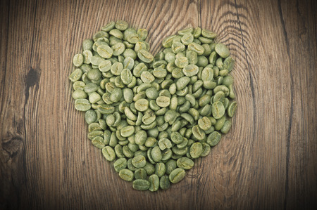 unprocessed: Heart made from coffee seeds on the wood