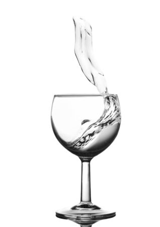 welling: Water in glass with water splash