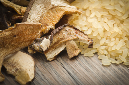 porcini: Rice and dried porcini mushrooms on table