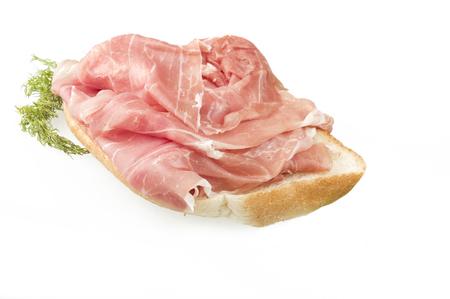 raw ham: sandwich with Italian prosciutto crudo ,raw ham leg sliced