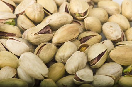 nutshells: Group of pistachio close up on white