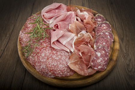italian salami: Wooden cutting board with various Italian salami Stock Photo