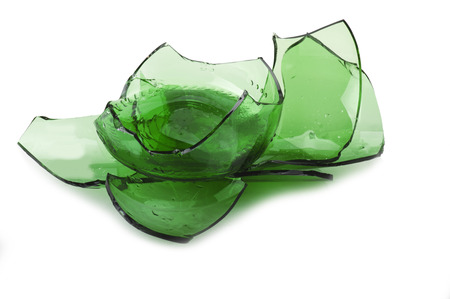 pieces of green glass on a white background