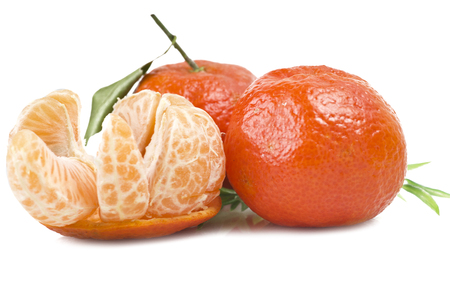 Mandarin or Tangerine fruit with leaves on a white background Stock Photo