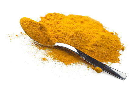 curative: dust of ground turmeric on the spoon