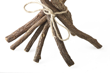 Licorice roots close up on the white