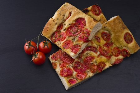 white pizza with tomatoes on the slate stone background Stock Photo