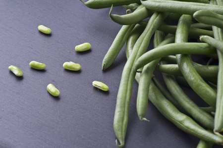 Group of fresh green bean on slate stone plate Stock Photo