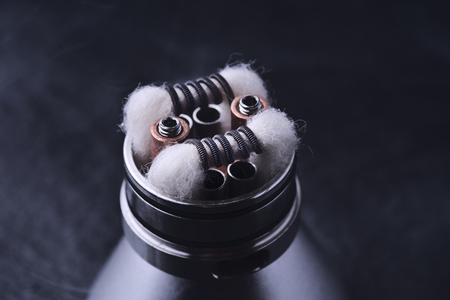 round: preparation of the atomizer for the electronic cigarette Stock Photo