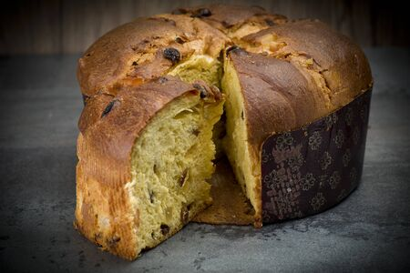 Panettone, sweet typical Italian Christmas on holiday background